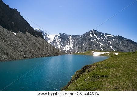 Amazing Mountain Landscape. Altay Stone Mushrooms. Mountain Like Flowing Between High Snow-capped Mo