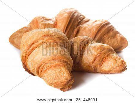 Three Fresh Baked Croissants Isolated On White Background