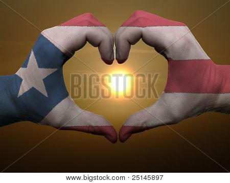 Heart And Love Gesture By Hands Colored In Puertorico Flag During Beautiful Sunrise