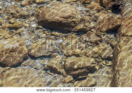 Textures, Reliefs And Forms On The Bottom Of A Mountain River. Photo Shows A Stone Texture. The Text