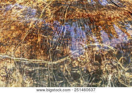 Stone Abstract Pattern In The Mountain River. Photo Shows A Stone Texture. The Texture Of The Stone,