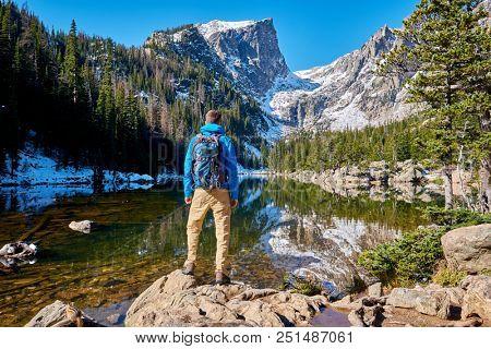 Tourist near Dream Lake at autumn in Rocky Mountain National Park. Colorado, USA.