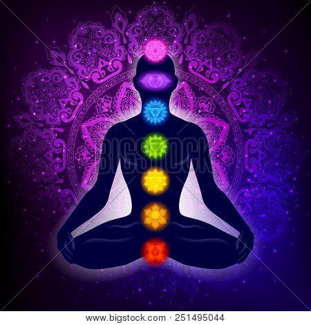 Meditating Human In Lotus Pose. Yoga Illustration. Colorful 7 Chakras And Aura Glow. Mandala Backgro