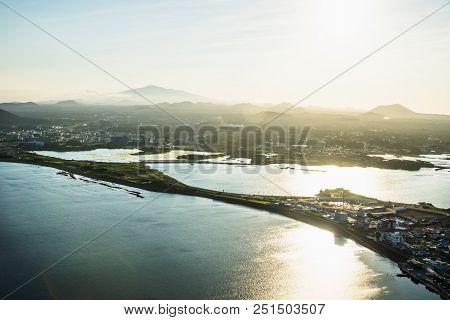 Sunset View To Hallasan Peak From Ilchulbong Peak To The City Of Seongsan, Jeju Island, South Korea