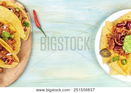 An Overhead Photo Of Mexican Food. Hot Spicy Tacos With Pulled Meat And Nachos With Cheese, Chilli C