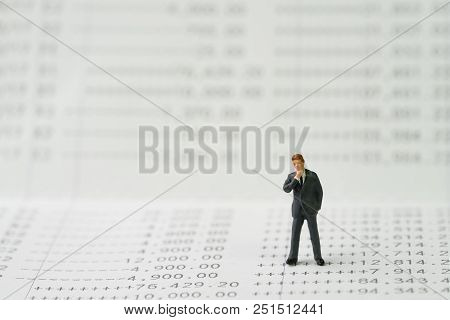 Saving Or Deposit Account, Compound Interest Or Banking Concept, Miniature Businessman Standing And
