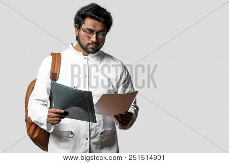 Young Hindu Man Is Going To Start Up Business Isolated On The White Background. Studing Concept. Stu