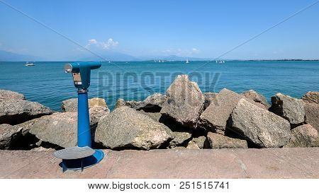 Viewing Telescope Monocular Overlooking Lake Garda In Lombardy, Italy