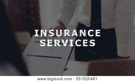 Concept Insurance Services Message On Background Business Man In The Office Fill Out Insurance Polic