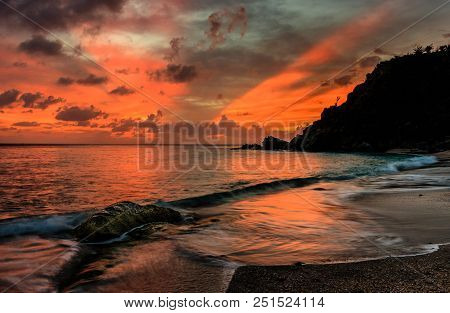 Travel Photo In St. Barths, Caribbean. View Of A Peaceful Sunset And Waves On Shell Beach.