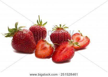 Strawberry With Sliced Half And Leaves Isolated On White Background With Clipping Path. One Of The B
