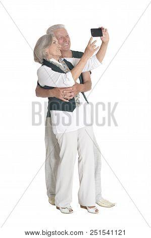 Full Length Portrait Of  Senior Couple Taking Selfie Isolated On White Background