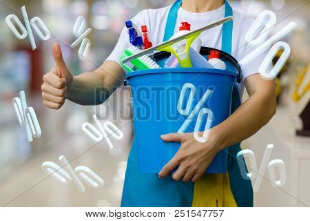 Cleaning Lady With A Bucket And Cleaning Products And Percentage Discount.