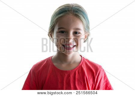 Cute Little Girl With A Cheerful Playful Grin And Colourful Dyed Highlights In Her Long Blond Hair S