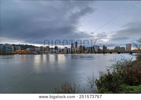Portland Oregon Downtown City Skyline And Hawthorne Bridge Over Willamette River Waterfront During E