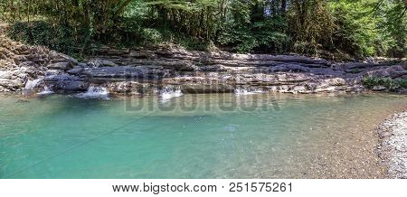 Cascade Rapids And Waterfalls On The River Dagomys. Sochi National Park. The Bizarre Form Of The Riv
