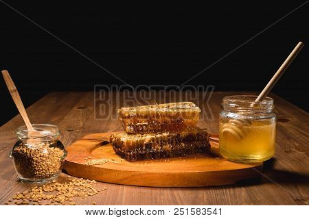 Jar Of Honey With Honeycomb On Wooden Table. Delicious Honey Honey