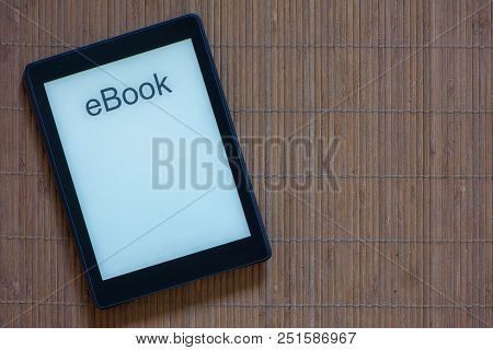 An E-reader With White Screen And Text Ebook