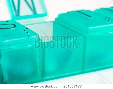 Extreme Close Up Of Seven Day Pill Box With Pills. Green Pill-box With Tuesday Pills Visible. Open P