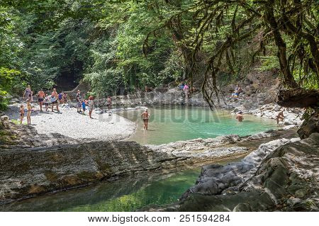 Sochi, Russia - July 25, 2018: Canyon Of The River Dagomys On A Day Off. People On The Beach Of A Mo