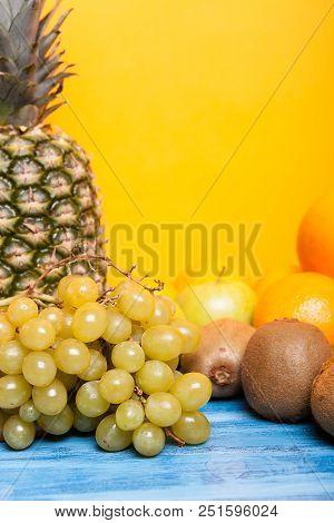 Mixed Tasty Fruit Composition Set On Yellow Background. Gourmet Freshness Gastronomy Alimentation