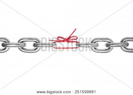 The weak link in the chain -Broken chain with piece of red string holding together, included clipping path