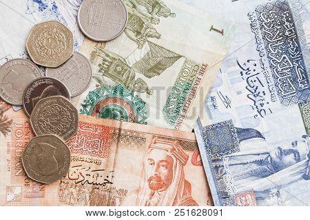 Jordanian Dinars Banknotes And Piastres Coins Close-up, Background Photo