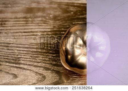Creative Layout Made Of Tomato On Wood Backgruond. Painted Purple And Gold. Food Concept