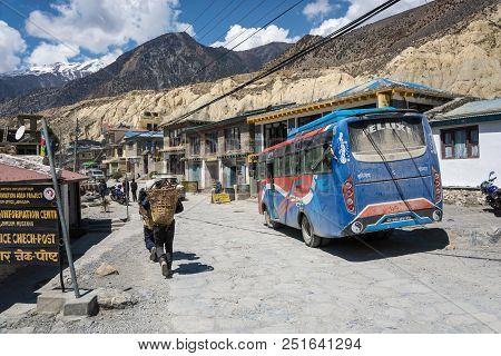 A Narrow Village Street In A Mountain Village On April 9, 2018, Jomson, Nepal.