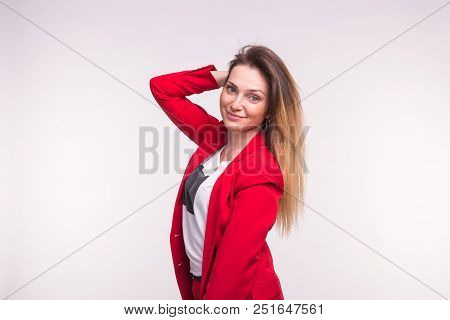 Stylish European Woman In A Red Jaket With Hand In Hair