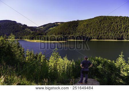 Tourist Looking Vidra Dam Lake In Parang Mountains