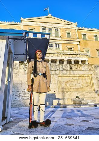 Athens, Greece - June 29, 2018. A Greek Presidential Guard, Evzone, Standing In Front Of Monument Of