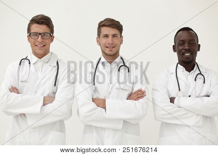 three successful physician therapists standing together
