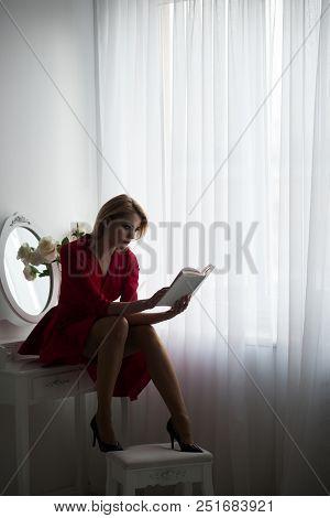 Learning At Home. Woman Learning At Home. Learning At Home For Sexy Woman In Bedroom. Learning And E