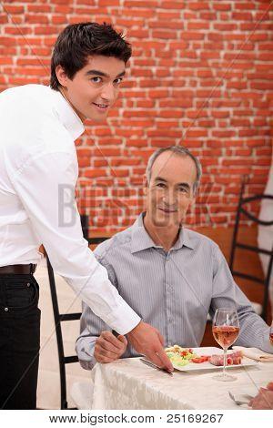 Waitor serving man