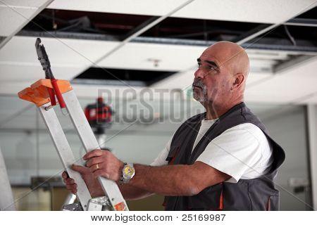 Man moving a ladder