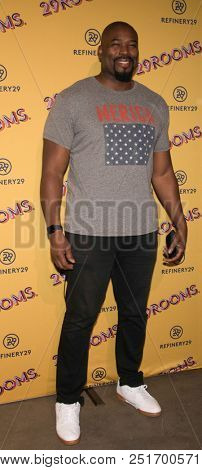 CHICAGO - JUL 25: Former NFL player Israel Idonije attends Refinery29's