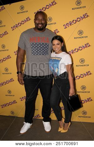 CHICAGO - JUL 25: Former NFL player Israel Idonije (L) and guest attend Refinery29's