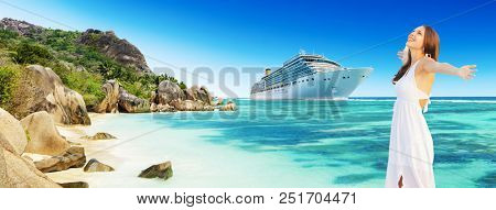 Happy young woman with luxury cruise boat on background. Tropical island on background. Concept of long-distance cruise among the continents. Seychelles island