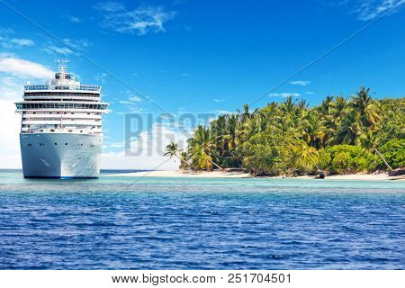 Luxury cruise boat with tropical island, panoramic view. Concept of long-distance cruise among the continents.