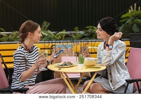 Informal Meeting. Two Promising Fashion Designers Feeling Joyful While Having Informal Meeting In Ca