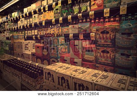 Vintage Various Selection Of Beer Bottles On Display At Supermarket