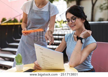 Advice Of Waiter. Successful Businesswoman Needing Help While Asking Advice Of Waiter While Choosing