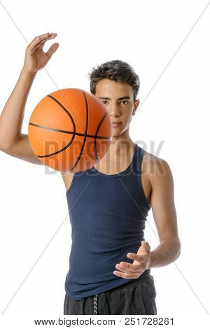 Portrait Of A Young Basketball Player Passing The Ball. Young Caucasian Boy In Sportswear Playing Ba