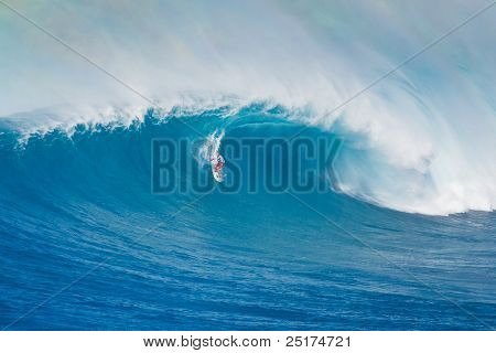 MAUI, HI - MARCH 13: Professional surfer Michel Larronde rides a giant wave at the legendary big wave surf break known as