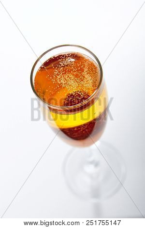 Bellini Cocktail with Prosecco Sparkling Wine and Peach Puree or Nectar Isolated on White Background. Summer Alcohol or Nonalcoholic Drink of Light Wine and Fruits Mixture Close Up