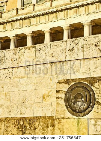 Athens, Greece - June 29, 2018. A Bronze Shield Representing An Classic Greek Helmet, On The Monumen