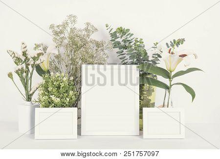 Blank Photo Frame On Wooden For Design Mockup Template.