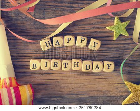 Happy Birthday, Wooden Dices On A Woodent Able With Birthday Decoration, Vintage Color Stylized