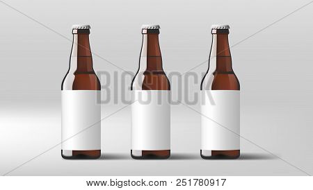 Realistic Clear Beer Bottles With White Label. Eps10 Vector